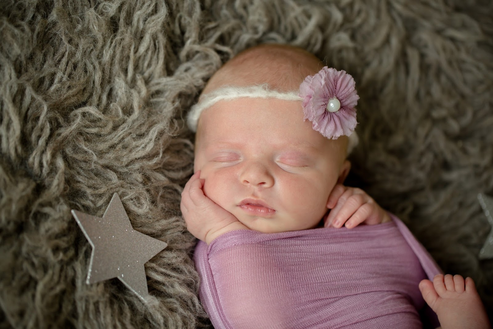 The moon and stars swaddled baby
