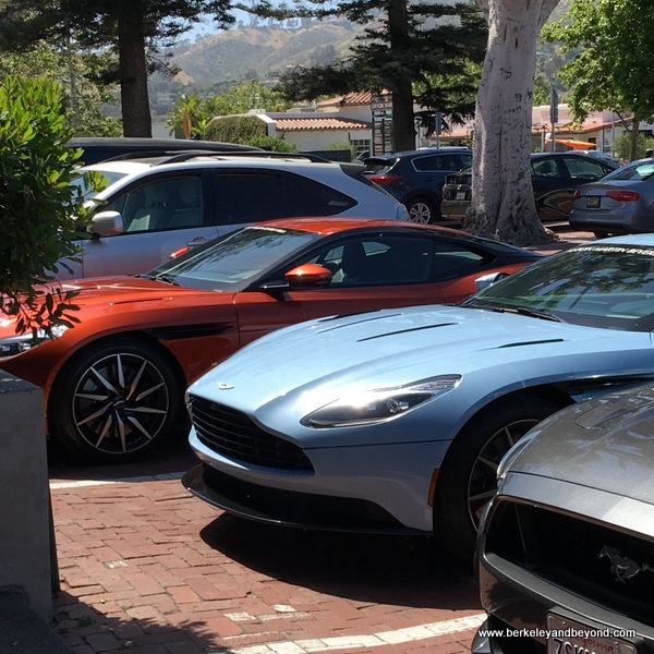 Aston Martins parked at Malibu Kitchen at Malibu Country Mart in Malibu, California