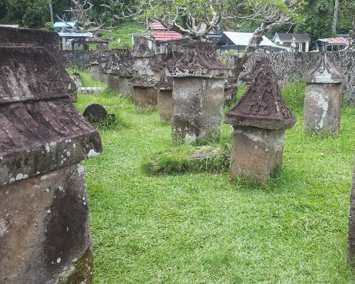 Travel.Tinuku.com Waruga park megalithic tombs sites containing stone coffins to bury the Minahasa in North Sulawesi
