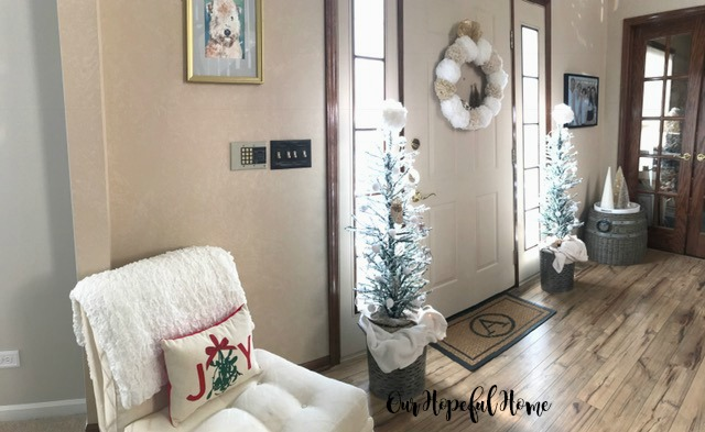 Christmas foyer Joy pillow pom pom wreath pom pom garland pencil trees