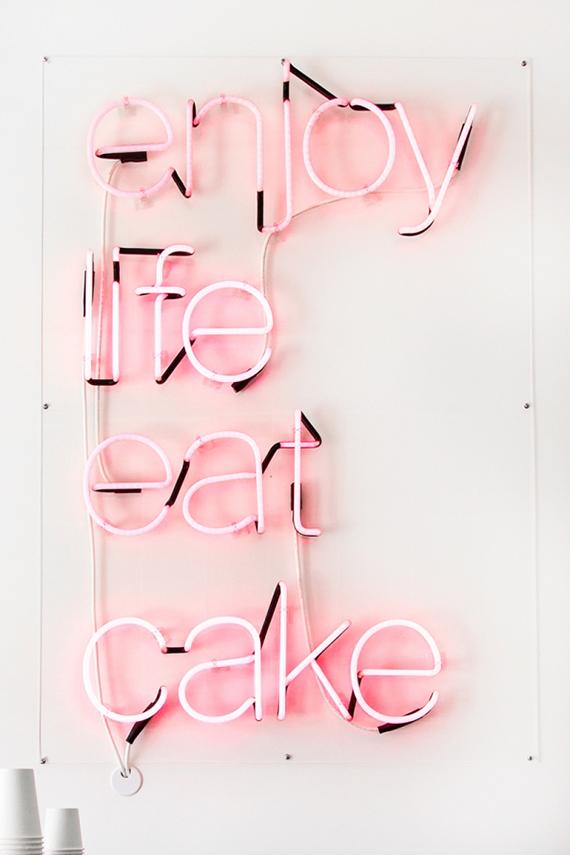 Enjoy Life And Eat Cake pink neon sign at Cake Monkey Bakeshop