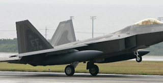 US F-22s intercept Russian fighter jets, fire warning flares