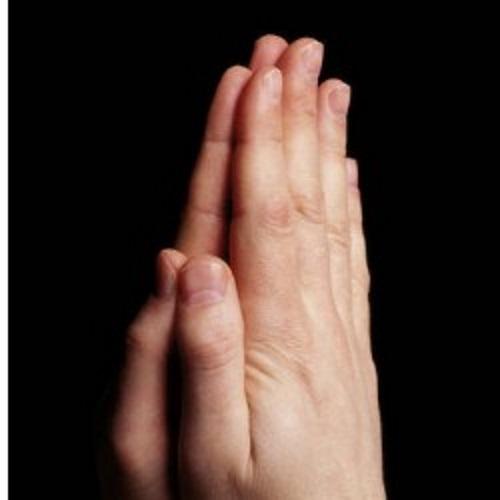 #PraCegoVer: Mãos orando.
