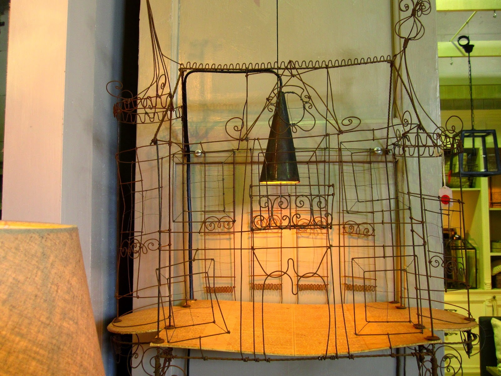 Vintage wire house, used as the basis for a lamp.