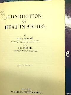 The title page of Conduction of Heat in Solids, by Carslaw and Jaeger, superimposed on the cover of Intermediate Physics for Medicine and Biology.