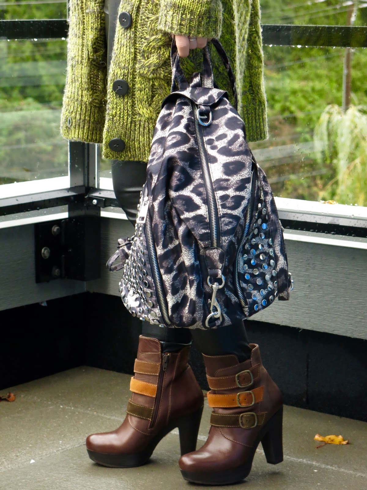 grandpa cardigan, faux-leather leggings, platform booties, and leopard-print backpack