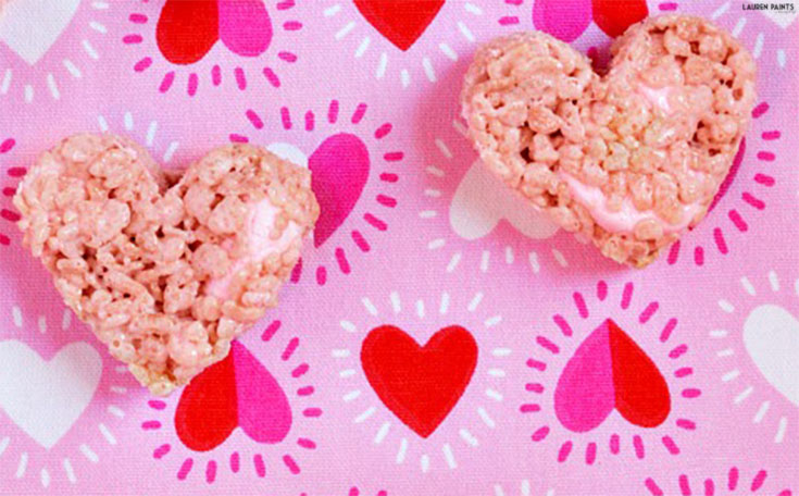 These tasty Valentine's Day Rice Krispy Treats are the perfect way to show you care, with a delightful strawberry flavor and the perfect amount of marshmallow gooey-ness!