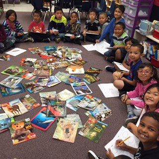 circle of students looking at books