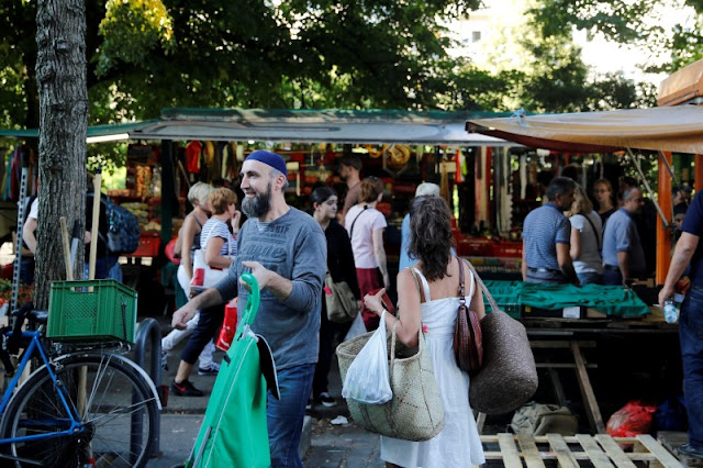 Image Attribute: People visit a market in Berlin's Kreuzberg district, Germany, August 19, 2016. Picture taken August 19, 2016. REUTERS/Axel Schmidt