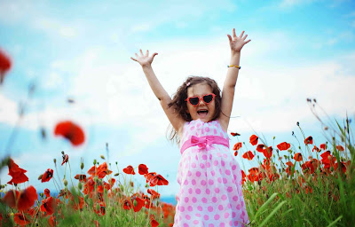 dancing-happybaby-girl-in-flower-garden