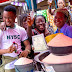 Lovely photos of graduate celebrating with his mother at the market after passing out of NYSC