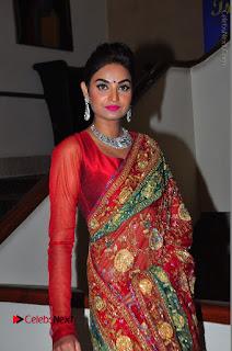 Model Sharon Fernandes Stills in Red Saree at Trendz Exhibition Launch  0008.JPG