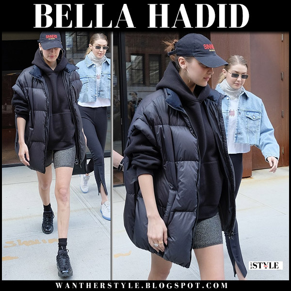 Bella Hadid in black padded gilet maison margiela and black sneakers nike air max 95 model street style may 2