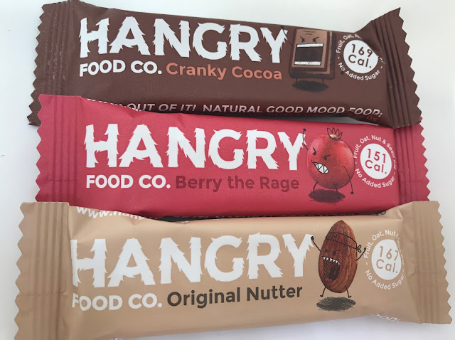 3 Hangry food co. bars: a brown one in cranky cocoa, a red one in berry the rage and a beige one in original nutter