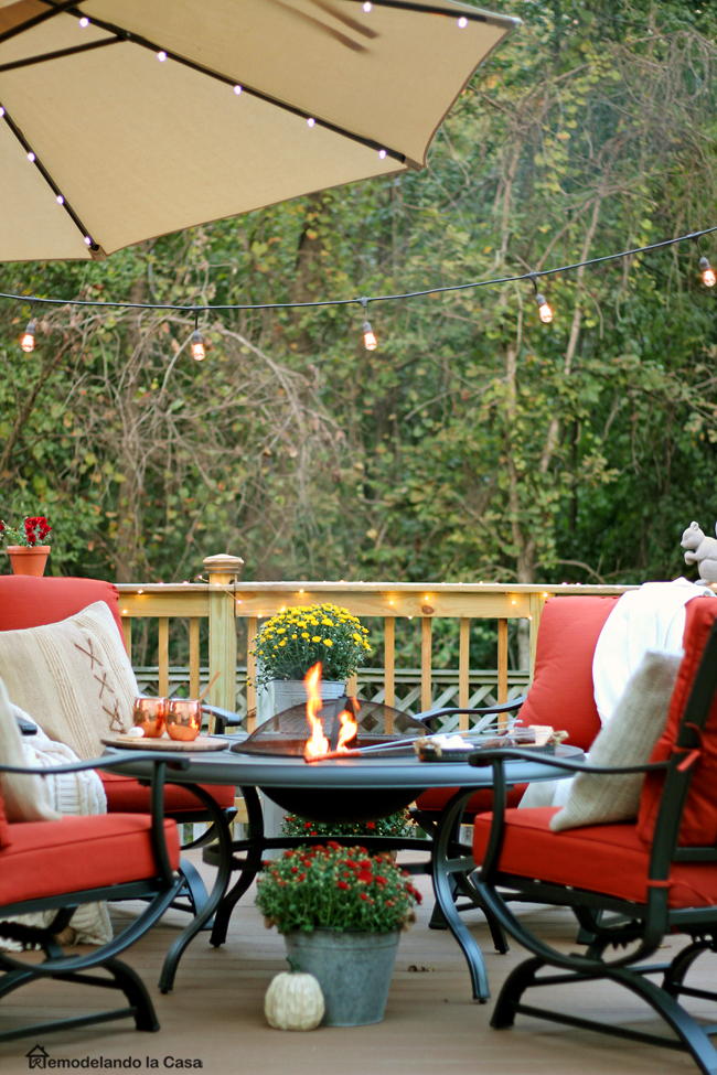 red patio set with firepit decorated for Fall