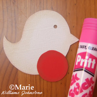 Using Pritt stick adhesive glue to stick on the red plummage