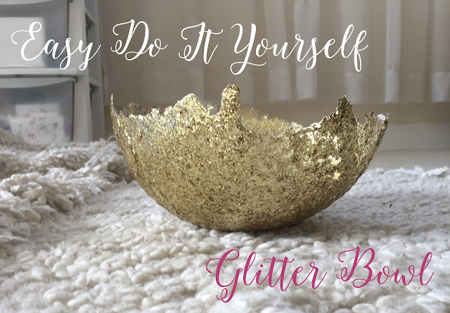 a gold glitter bowl sitting on a soft white blanket; text reads easy do it yourself glitter bowl