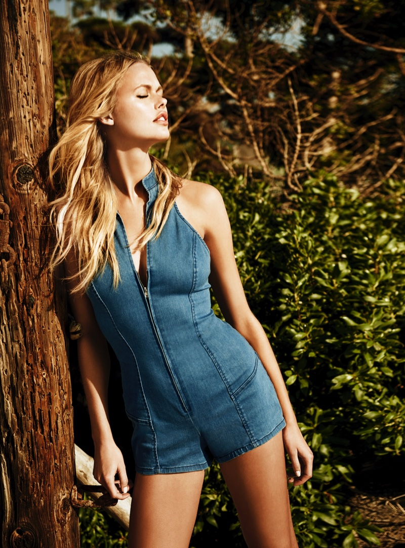 Starring in Guess Jeans summer 2016 campaign, Emma stern wears zip-up denim one-piece