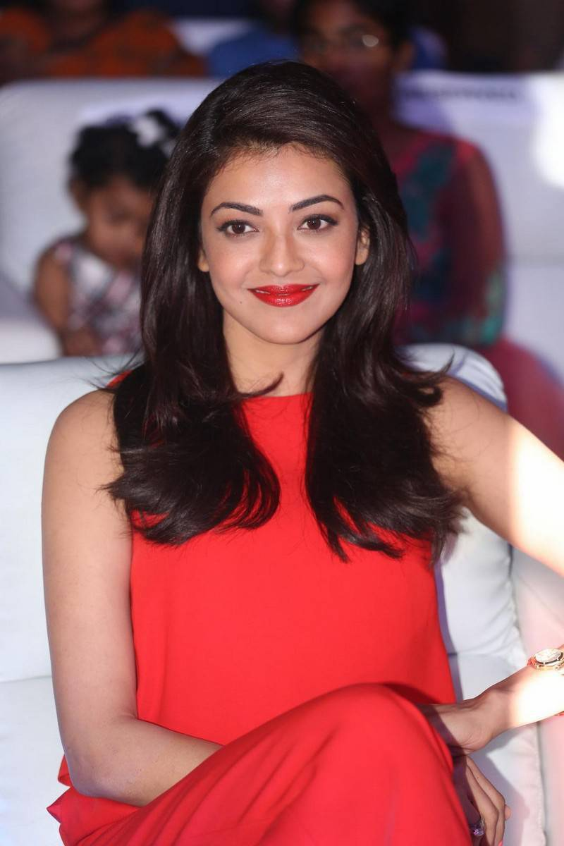 Kajal Photos In Orange Dress
