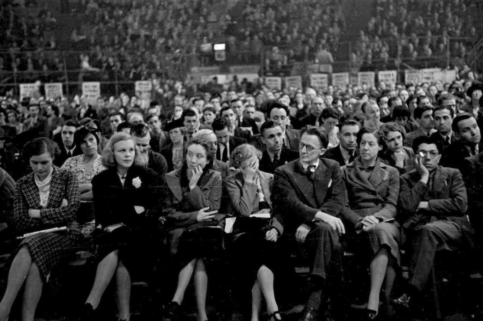 Members of the crowd at a meeting of the British Communist Party at the Empress stadium in Earls Court, London. 1939.