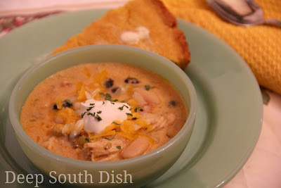 A creamy version of chicken tortilla soup, made with cooked chicken and fajita seasonings. Served with a garnish of crispy tortilla strips, shredded cheese, sour cream and served here with a side of sour cream cornbread.