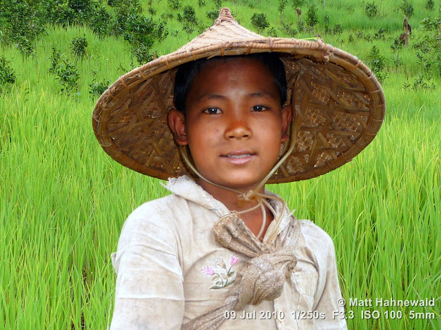 Asian conical hat, conical straw hat, Laotian style conical hat, sedge hat, rice hat, paddy hat, Laotian boy, portrait, headshot, Phongsali