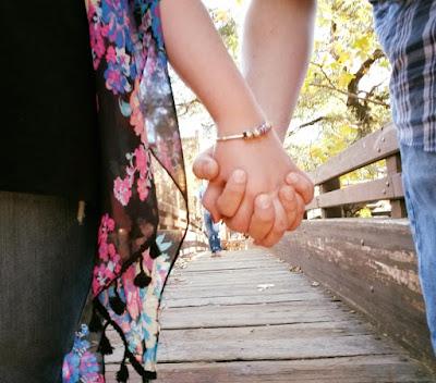 Crystal holding her boyfriend's hand.