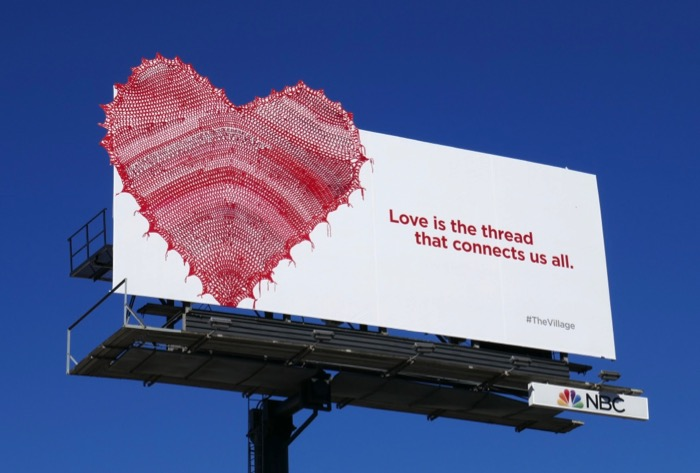 Love is thread connects us all Village teaser billboard