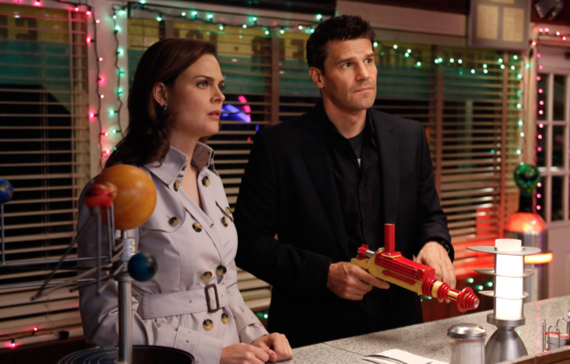 Emily Deschanel and, holding a colorful toy ray-gun, David Boreanaz in 'Bones'