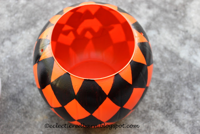 Eclectic Red Barn: Painted orange pumpkin with painted black diamonds