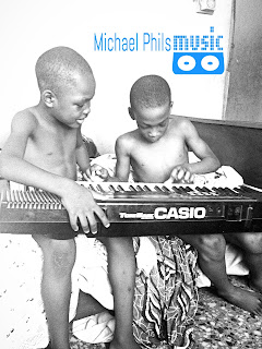 Nigerian children learning to play the piano