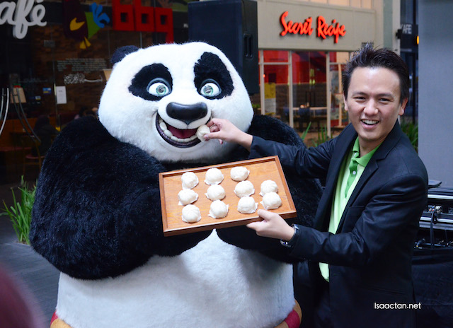 CEO Terry Lee feeding PO kungfu panda a delicious organic pau