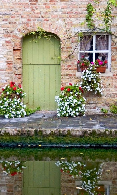 Charming vintage painted door at canal in Bruges - found on Hello Lovely Studio