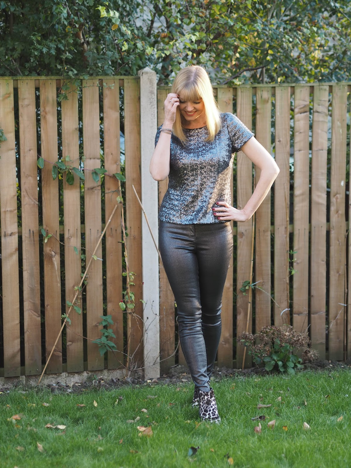 Gunmetal sequin top, silver metallic skinny jeans, snow leopard print boots, over 40