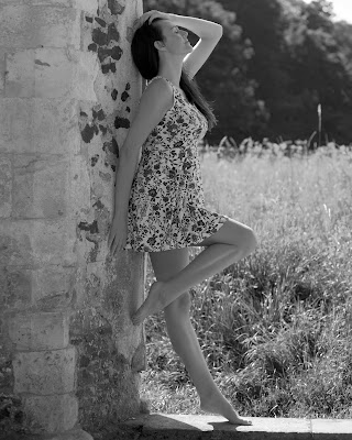 model leaning against a wall waverley abbey black and white