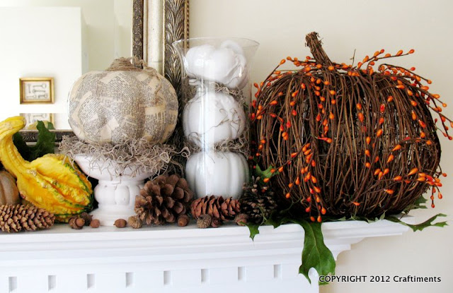 Craftiments:  Dictionary page decoupaged pumpkin, spray painted white pumpkins in a vase, and a twig pumpkin