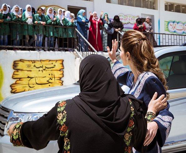 Queen Rania of Jordan wears Basmet Al-Khair Charitable Society' traditional Jordanian dress. Queen Rania wore Talitha Salma embroidered dress
