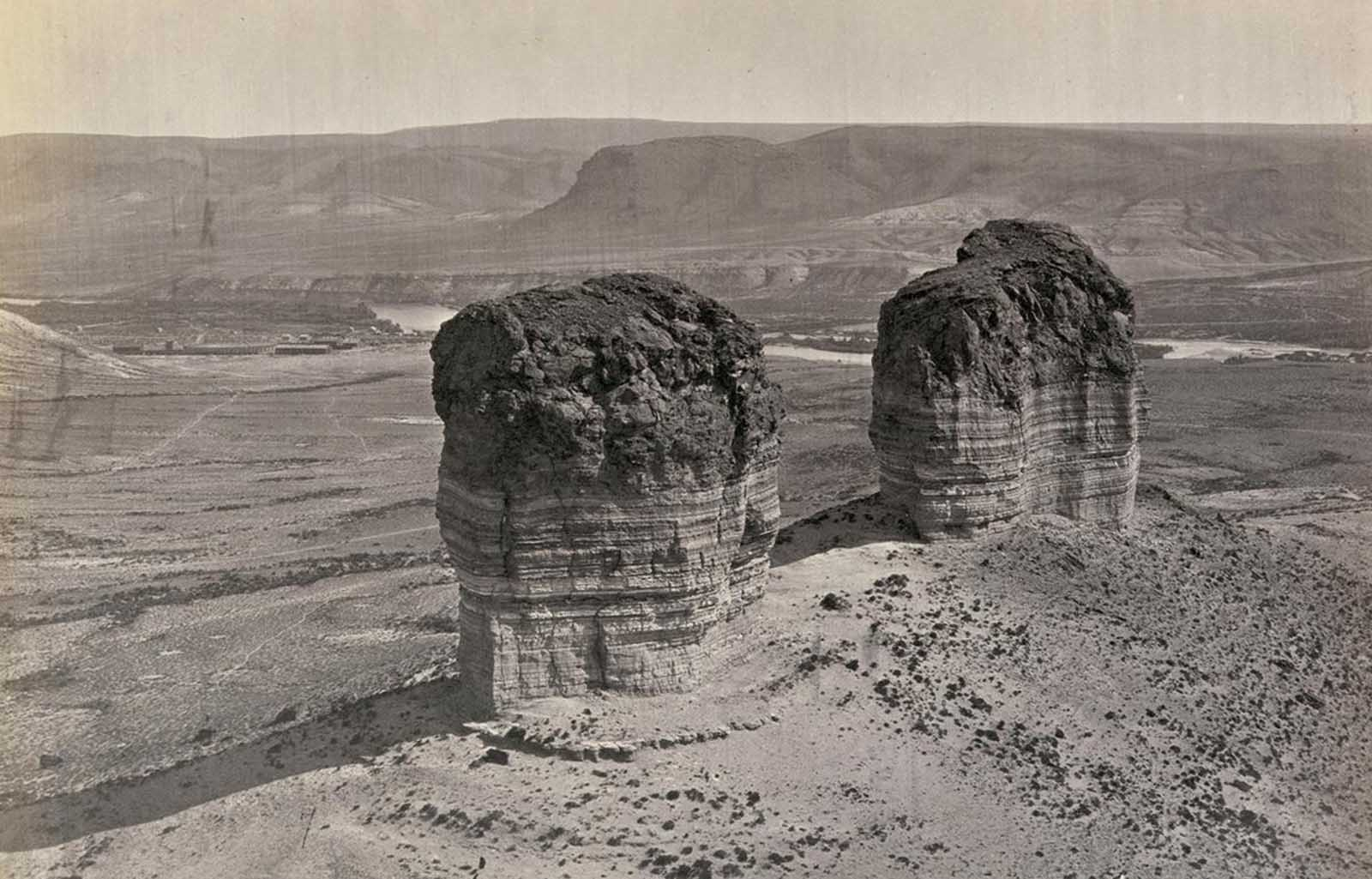 Twin buttes stand near Green River City, Wyoming, photographed in 1872.