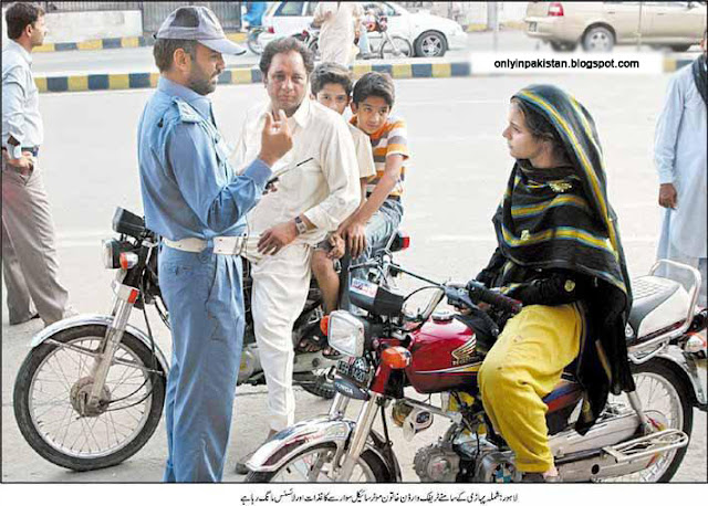 Pakistan Policeman and female motorcyclist