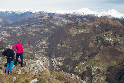 Two fellow hikers on Monte Zucco survey San Pellegrino in the Brembana valley.
