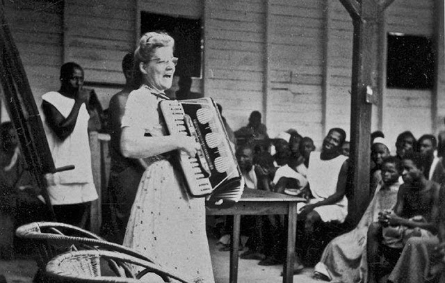 An enthusiastic missionary plays the accordion for a congregation in Africa. c. 1940s. Want to trade? marchmatron.com