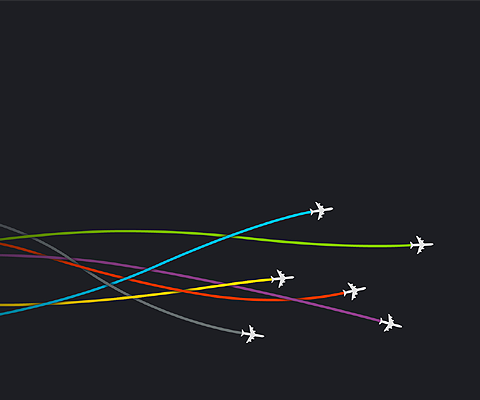 Plane Minimalism: Image of a black sky with 6 jet planes criss-crossing with coloured vapour trails.
