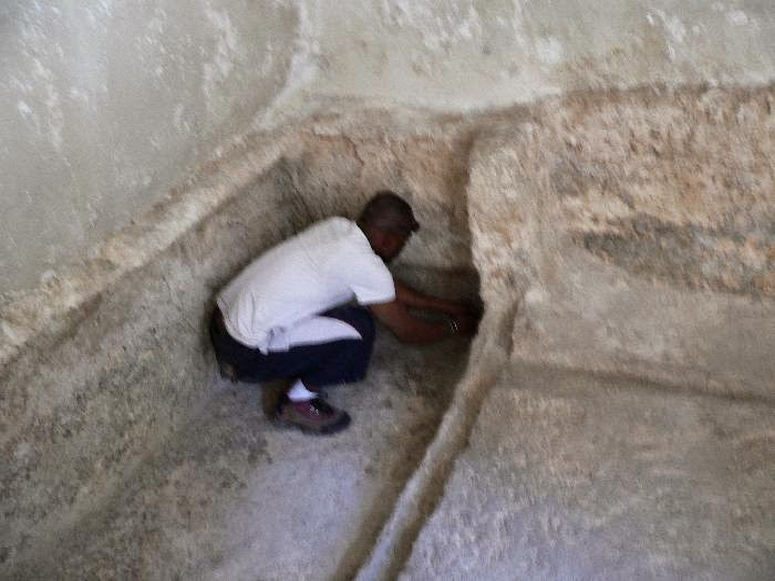 """Peter from Simons team measuring the grave of Jesus in the Garden Tomb, which conforms exactly, to the HEIGHT OF THE MAN ON THE SHROUD WHICH IS ABOUT 5'11"""""""