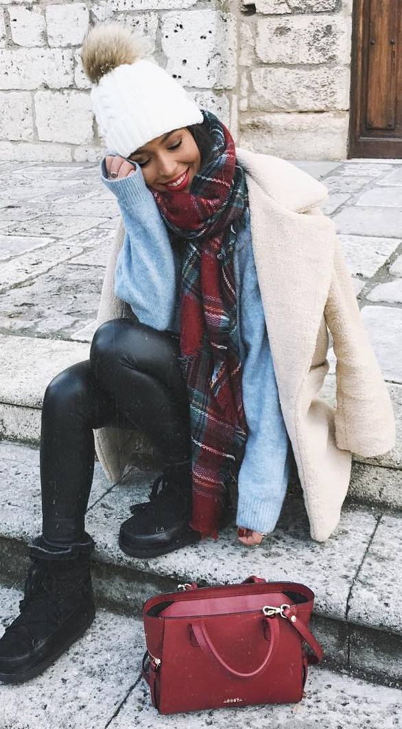 how to wear a plaid scarf : coat + hat + blue sweater + leather leggings + boots + bag