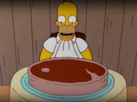Homero comiendo un bife gigante