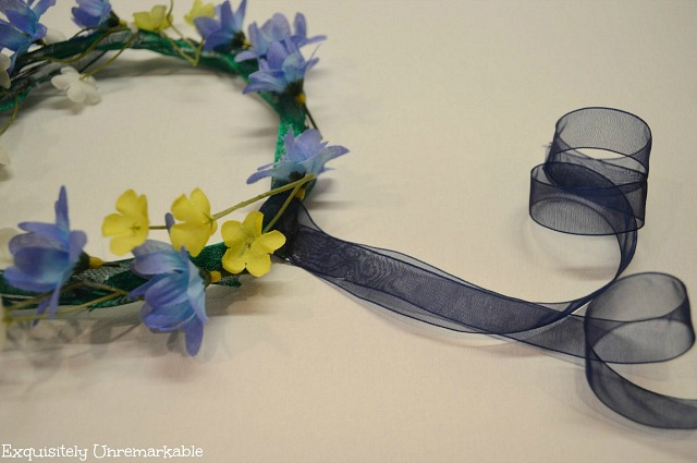 Floral Headdress With Blue Ribbon Tail