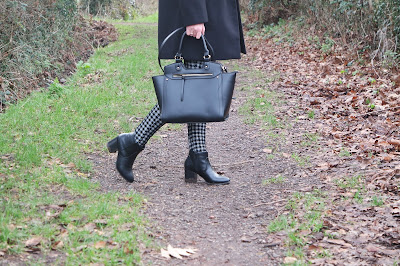 Monochrome winter outfit, with patterned check trousers fur collared coat and chelsea boots. Beauty Blogger OOTD. Curled Hair. Black Bag. Fashion Blogger.