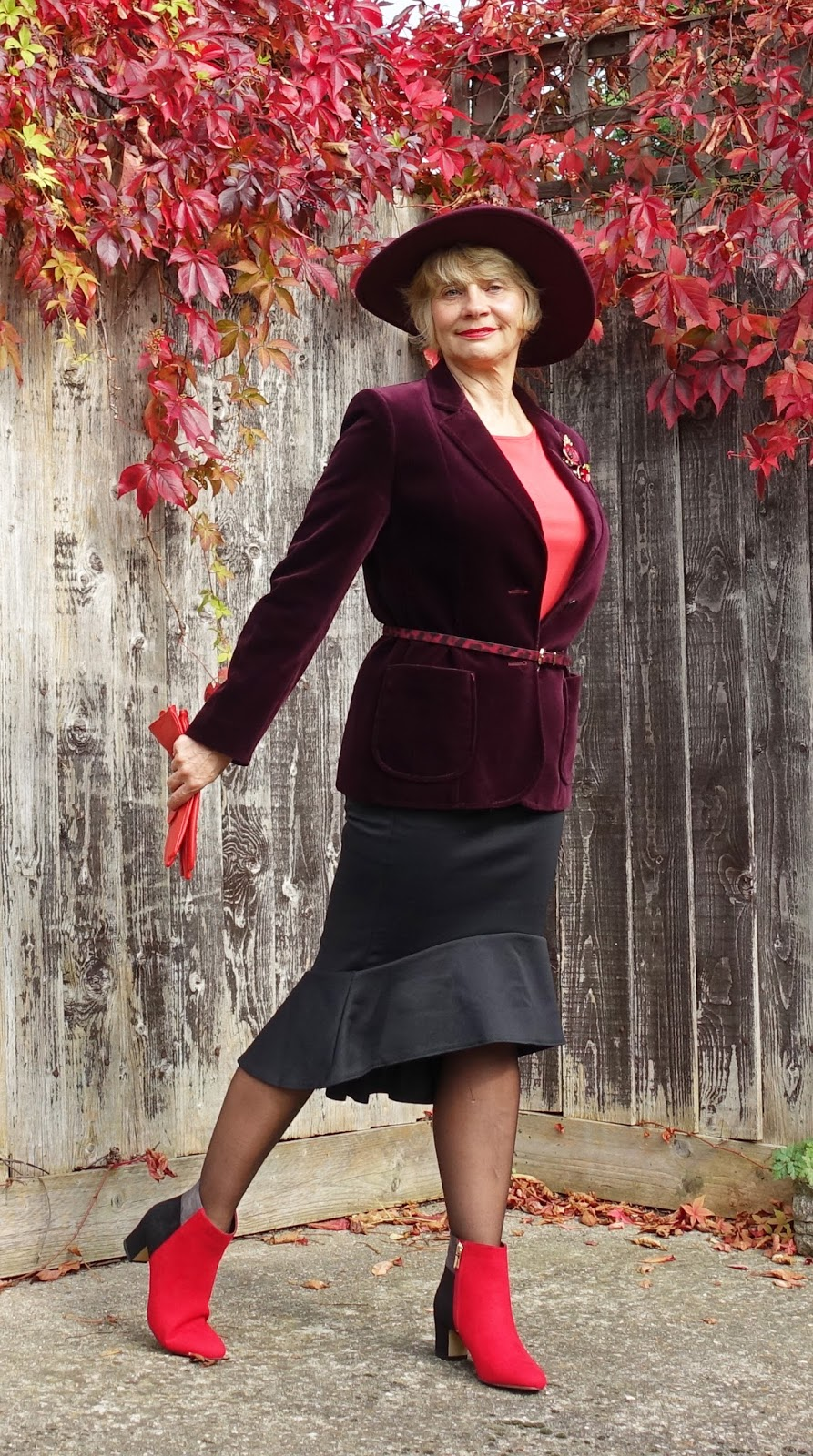 Hats look great with tailored outfits like this velvet jacket and trumpet hem skirt