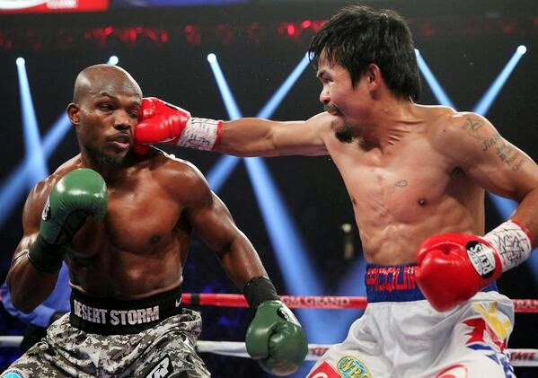 Manny Pacquiao reclaims welterweight title against Timothy Bradley