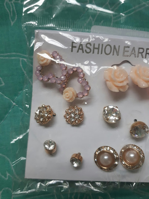 http://www.rosegal.com/earrings/faux-pearl-rhinestone-flower-heart-1161850.html?lkid=88196